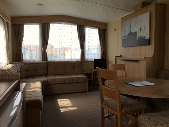 Photo of a living room in one of our holiday caravans